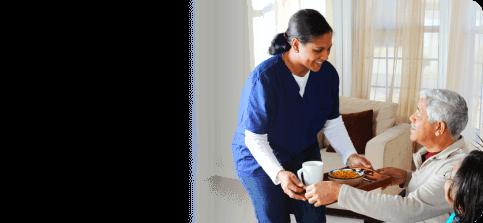 caregiver assisting elderly woman on bath