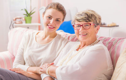 caregiver and elderly woman sitting