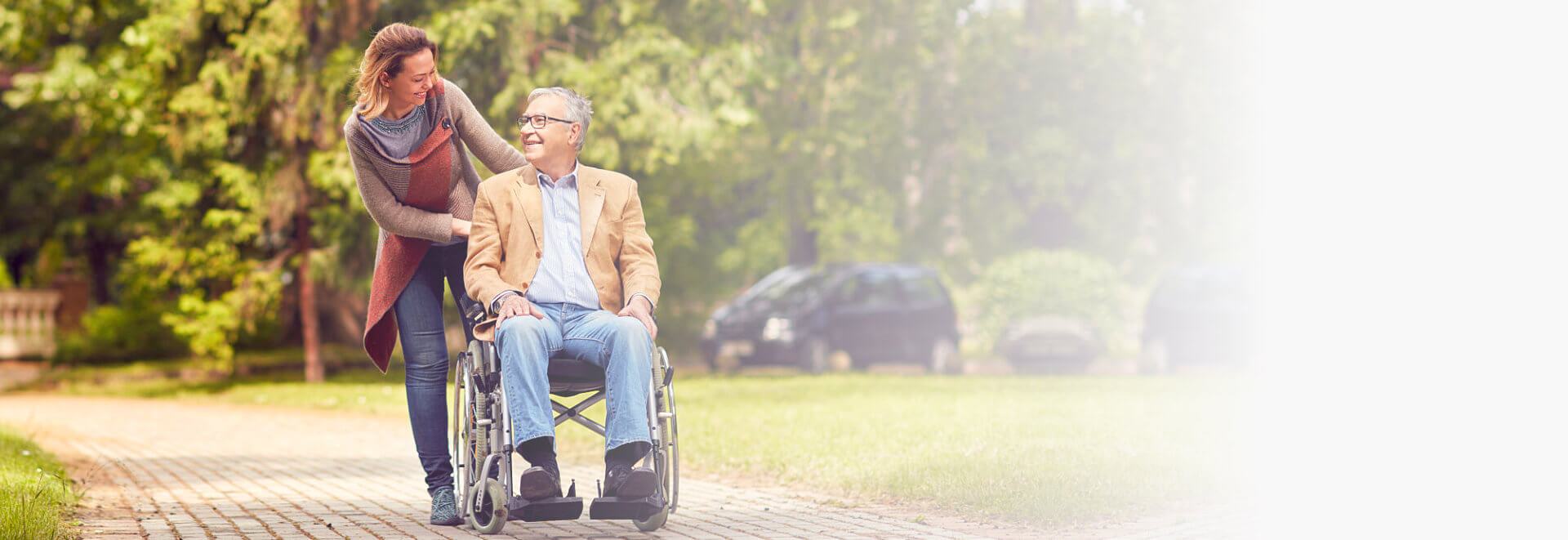 caregiver and elderly man at the park