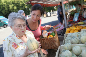 caregiver and elderly woman shopping