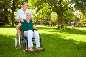 caregiver and elderly woman in the lawn