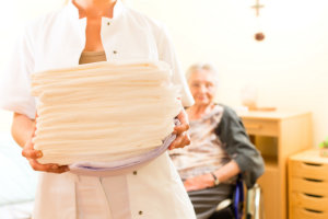 caregiver holding adult diaper
