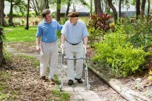 caregiver assisting elderly man