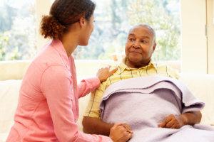caregiver and elderly man sitting